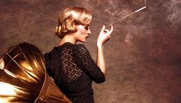 Woman smoking from cigarette holder