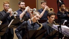Saxophone and trumpet players of the Academy Jazz orchestra