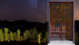 Field, night sky, wooden door